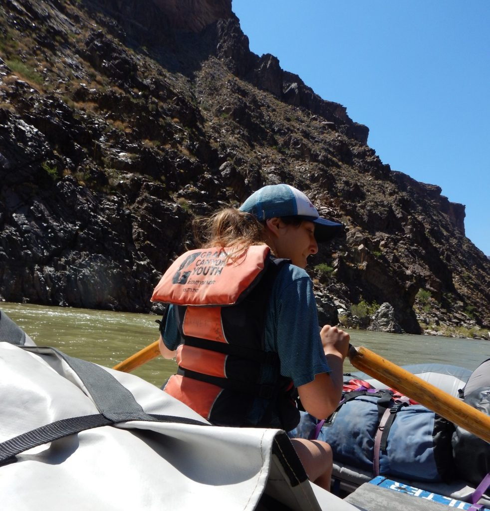 Grand Canyon Youth participant rowing a boat