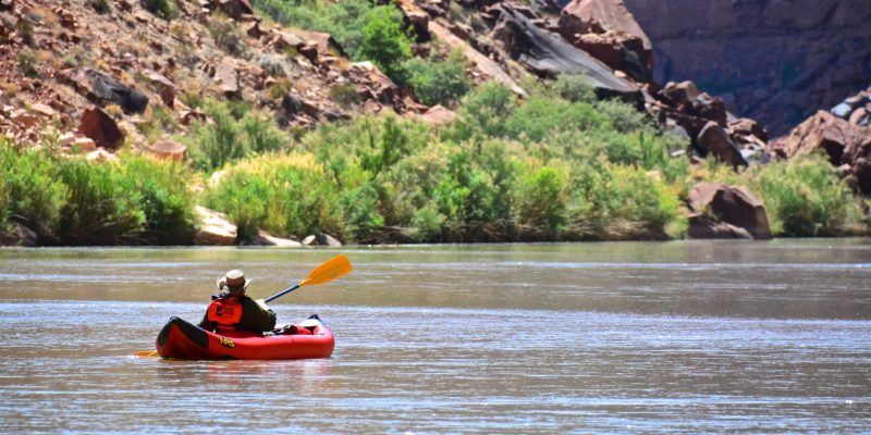 Grand Canyon Youth alumni paddling an inflatable kayak