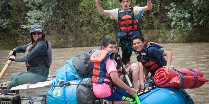 Grand Canyon Youth guide on a boat with kids