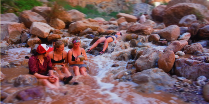 Grand Canyon Youth alumni sitting the colorado river